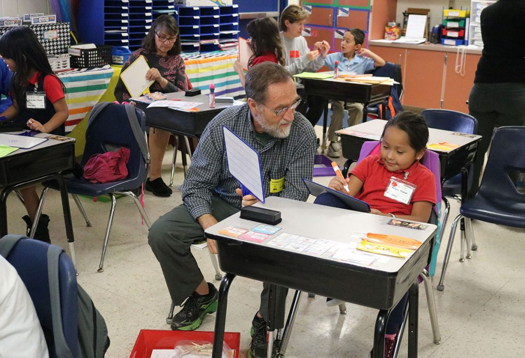 PCAT volunteer Rob Davies tutors Arianna Roman at Ruskin Elementary School. Most of the program's volunteer tutors are seniors, said founder Christene Worley.