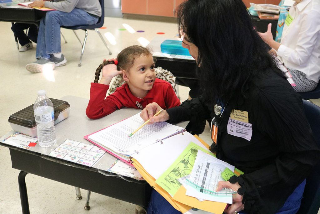Ruskin Elementary School kindergartener Ixayanna Linares listens intently as Desi Ferreira, of The Observer News, works with her during a PCAT Literacy Ministry tutoring session.